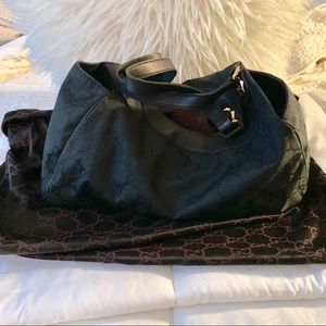 Authentic Gucci GG monogram nylon medium hobo bag.